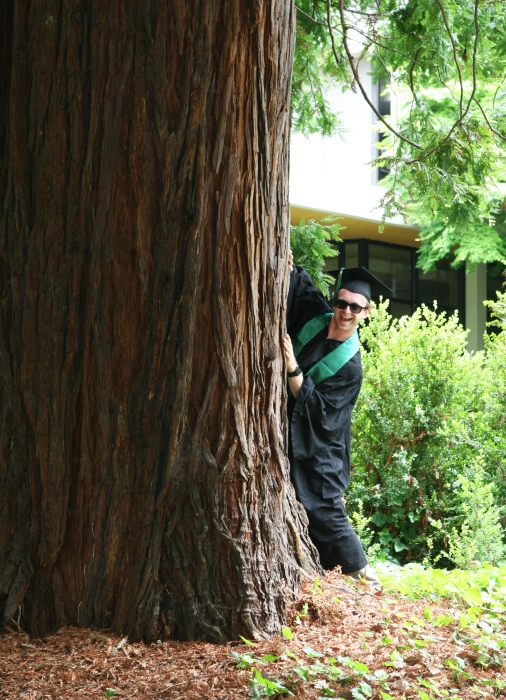 8. goofy grad behind a tree