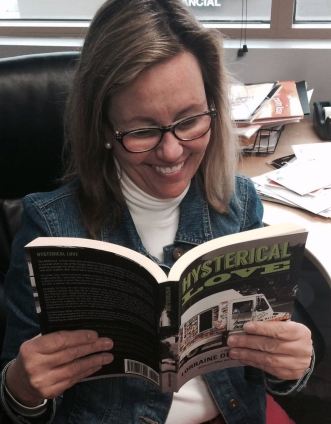 My publicist, Julie Schoerke of JKSCommunications enjoying an advanced read!